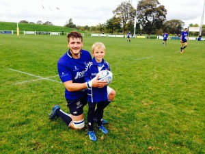 Alfie with Blues Captain Michael Finnemore
