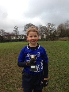 Olly with Player of the Week Trophy