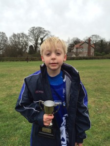 Oliver with Player of the Week Trophy