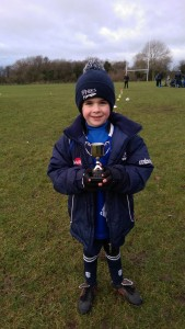 Oscar with Player of the Week Trophy