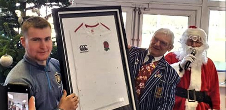 Harry Oliver presenting his U18 England shirt to the Club