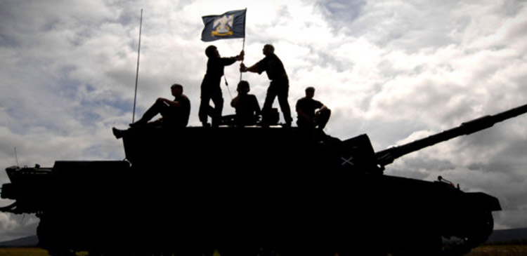 army tank soldiers placing flag