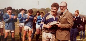 Captain Peter Harper receiving the Club's first silverware